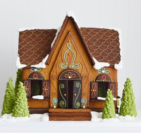 A little cottage-like house made of gingerbread.