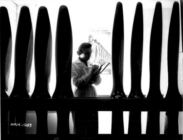 historic image of a woman counting airplane propellers